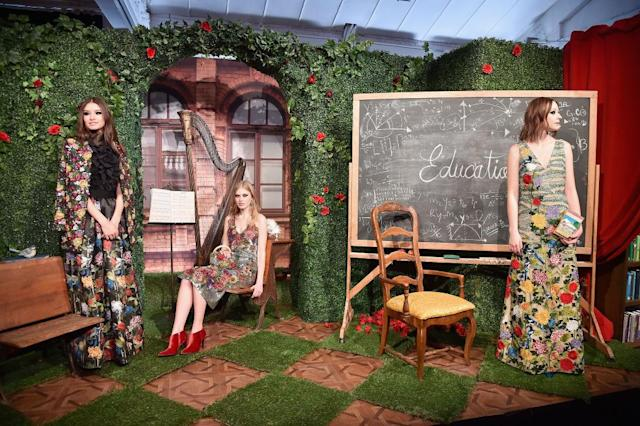 <p>Models wear a colorful collection of floral, maximalist printed trousers, jackets, and dresses at the feminist Alice + Olivia FW18 presentation. (Photo: Getty Images) </p>