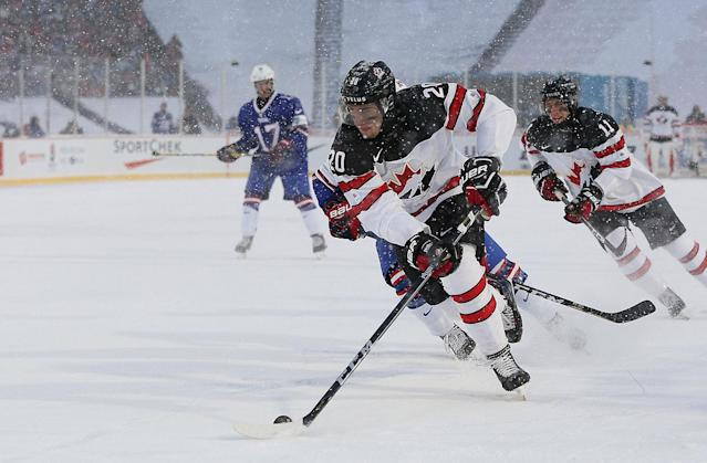 <p>Canada and the U.S. played the first ever world junior outdoor game, with the Americans rallying for a shootout victory in brutal conditions. (Photo by Kevin Hoffman/Getty Images) </p>