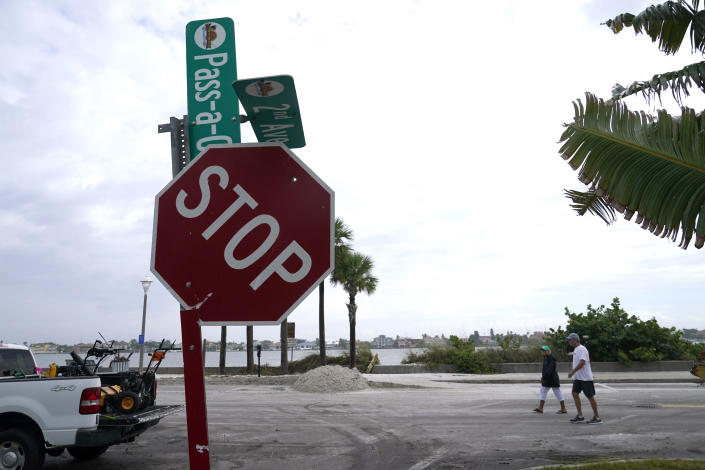 A street sign is damaged in the aftermath of Tropical Storm Eta, Thursday, Nov. 12, 2020, in the Passe-A-Grille neighborhood of St. Pete Beach, Fla. Eta dumped torrents of blustery rain on Florida's west coast as it slogged over the state before making landfall near Cedar Key, Fla. (AP Photo/Lynne Sladky)