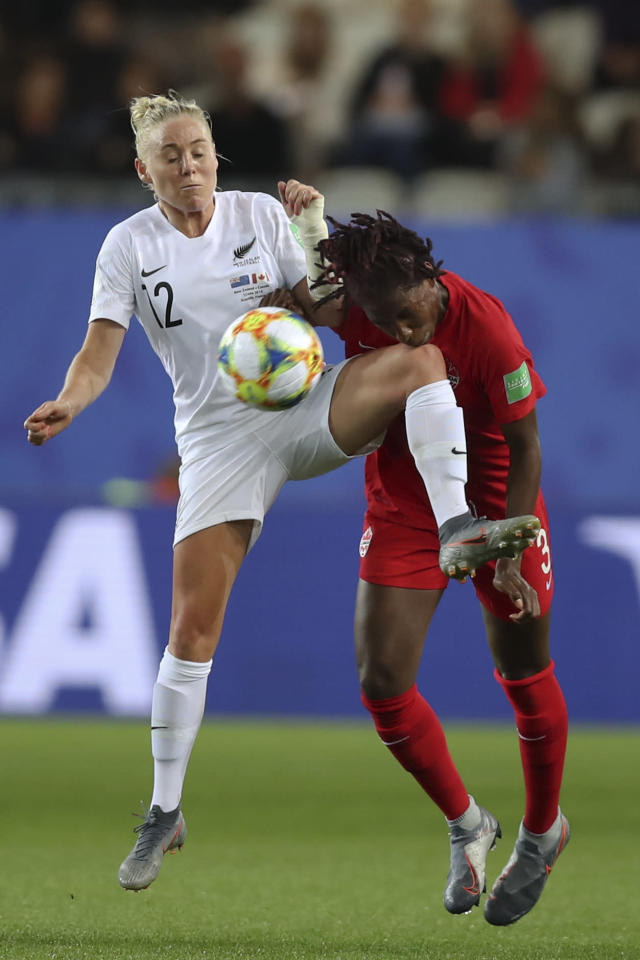 Canada's Kadeisha Buchanan compete for the ball with New Zealand's Betsy Hassett during the Women's World Cup Group E soccer match between Canada and New Zealand in Grenoble, France, Saturday, June 15, 2019. (AP Photo/Francisco Seco)