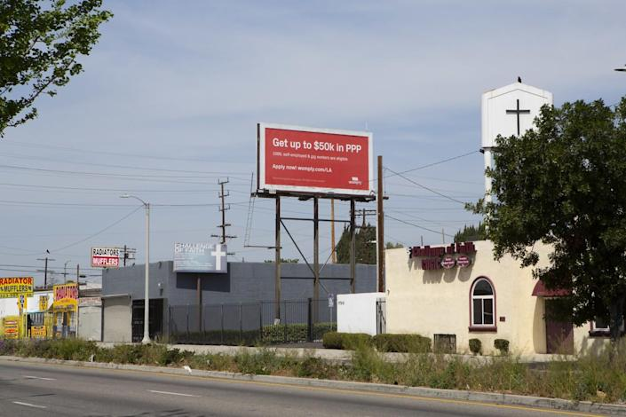 A red billboard says Get up to $50k in PPP