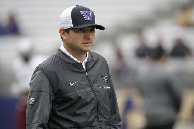 """<a class=""""link rapid-noclick-resp"""" href=""""/ncaaf/players/263416/"""" data-ylk=""""slk:Jonathan Smith"""">Jonathan Smith</a>, offensive coordinator and quarterbacks coach for Washington, stands on the field during warmups before an NCAA college football game against Montana, Saturday, Sept. 9, 2017, in Seattle. (AP Photo/Ted S. Warren)"""