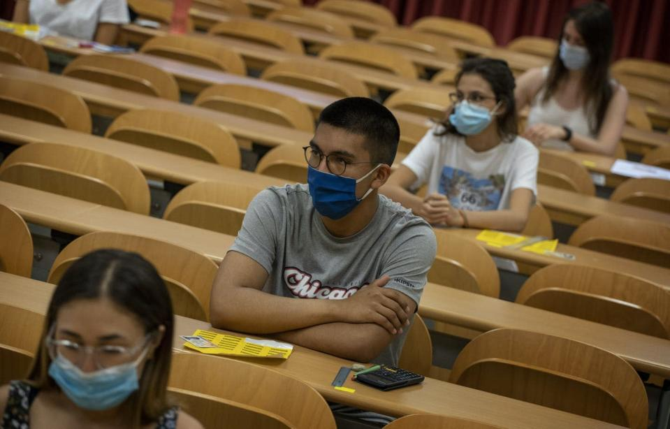 """<span class=""""caption"""">Many people are wondering if COVID-19 could spell the end of university admission testing. Young people at the Autonomous University of Barcelona on July 7, 2020. </span> <span class=""""attribution""""><span class=""""source"""">(AP Photo/Emilio Morenatti)</span></span>"""