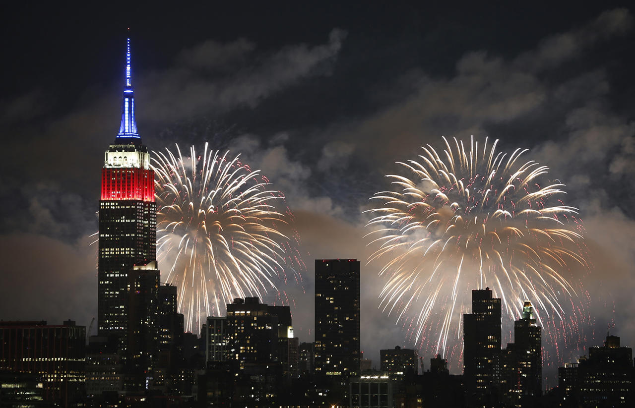 <p>The Macy's fireworks show lights up the sky over New York City on July 4, 2017, as seen from Union City, NJ. (Gary Hershorn/Getty Images) </p>