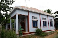A new house in Cambodia built through microfinancing whose owner fled to escape huge debts