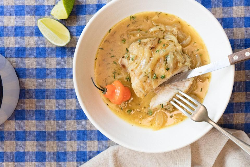 """Smothered pork chops may be an iconic soul food specialty, but this recipe proves you can smother anything. All it really means is coating slow-cooked meat with a blanket of saucy aromatics that end up as gravy too. Here, I've buried chicken thighs under a Caribbean-inspired coconut milk simmer of onions, garlic, and, of course, chile. Finally, the curry powder and lime balance the richness with spiced heat and a bright citrus pop. <a href=""""https://www.epicurious.com/recipes/food/views/caribbean-smothered-chicken-with-coconut-lime-and-chiles?mbid=synd_yahoo_rss"""" rel=""""nofollow noopener"""" target=""""_blank"""" data-ylk=""""slk:See recipe."""" class=""""link rapid-noclick-resp"""">See recipe.</a>"""