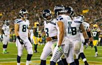 Seattle Seahawks quarterback Russell Wilson (3) celebrates his touchdown pass with teammates during the second half against the Green Bay Packers at Lambeau Field. Sep 20, 2015; Green Bay, WI, USA. Ray Carlin-USA TODAY Sports