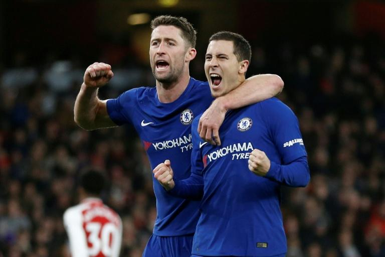 Chelsea's Eden Hazard (R) celebrates with teammate Gary Cahill after scoring a goal during their English Premier League match against Arsenal, at the Emirates Stadium in London, on January 3, 2018