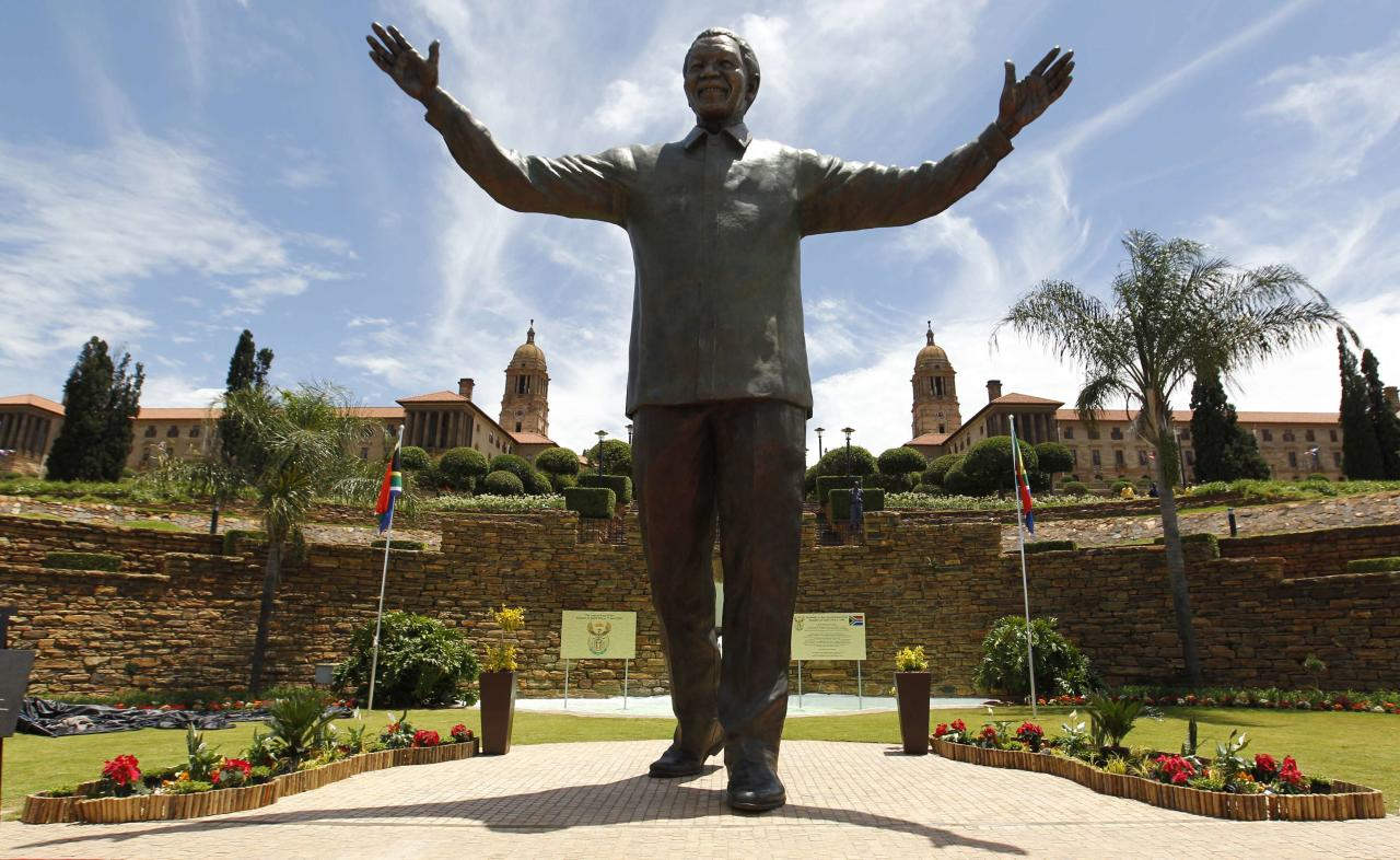 A 9-metre (30-feet) bronze statue of the late former South African President Nelson Mandela is unveiled as part of the Day of Reconciliation Celebrations at the Union Buildings in Pretoria December 16, 2013. The day also marks the commemoration of the centenary of the Union Buildings, one of the most iconic structures in South Africa. The unveiling of the statue on 16 December 2013 is intended as acknowledgement of the contribution of the first President of a democratic South Africa, a symbol of national reconciliation and unity. REUTERS/Thomas Mukoya (SOUTH AFRICA - Tags: OBITUARY TRAVEL POLITICS ANNIVERSARY TPX IMAGES OF THE DAY)