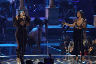 Jazmine Sullivan, left, and JT, of City Girls, perform at the BET Awards on Sunday, June 27, 2021, at the Microsoft Theater in Los Angeles. (AP Photo/Chris Pizzello)