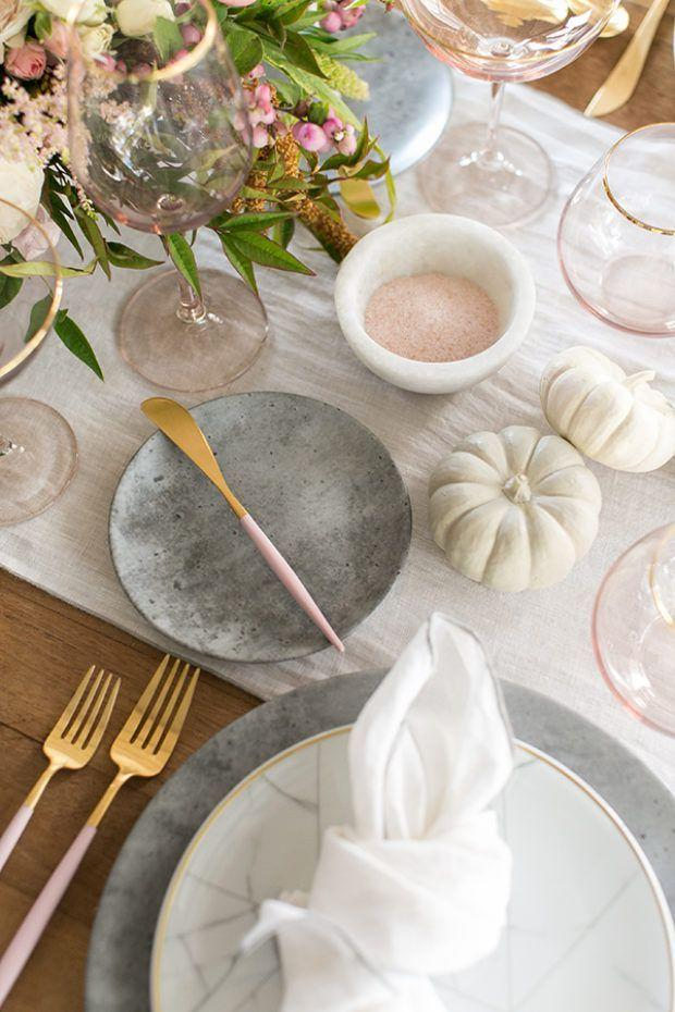 "<p>OK, so pink doesn't necessarily spring right to mind when you think of Thanksgiving. But when paired with gray and white, then accented with gold, it's seriously elegant. As long as your table looks good, no one will question it. </p><p>See more at <a href=""https://sugarandcharm.com/2017/11/5-steps-to-a-beautiful-thanksgiving-tablescape.html?section-21"" target=""_blank"">Sugar and Charm</a>.</p>"