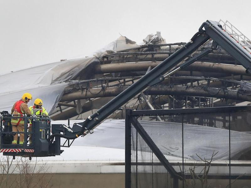 Fire crews work at the scene at Chester Zoo (PA)
