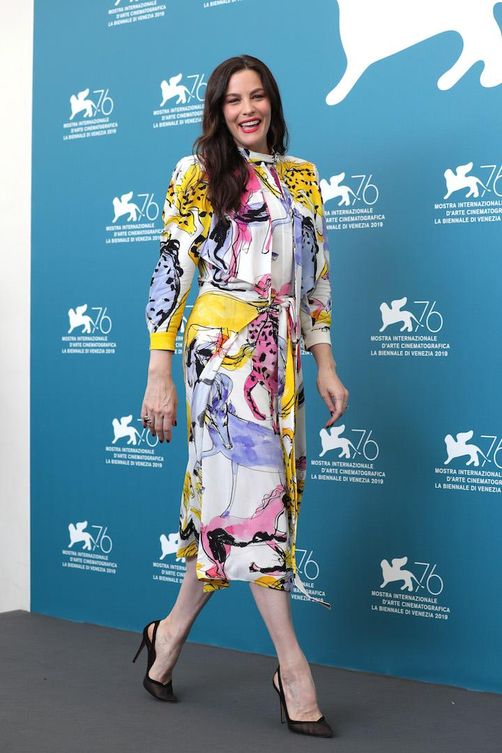 For the 'Ad Astra' photo call, Liv Tyler reminded us that summer isn't over just yet in a vibrant printed dress. <em>[Photo: Getty]</em>