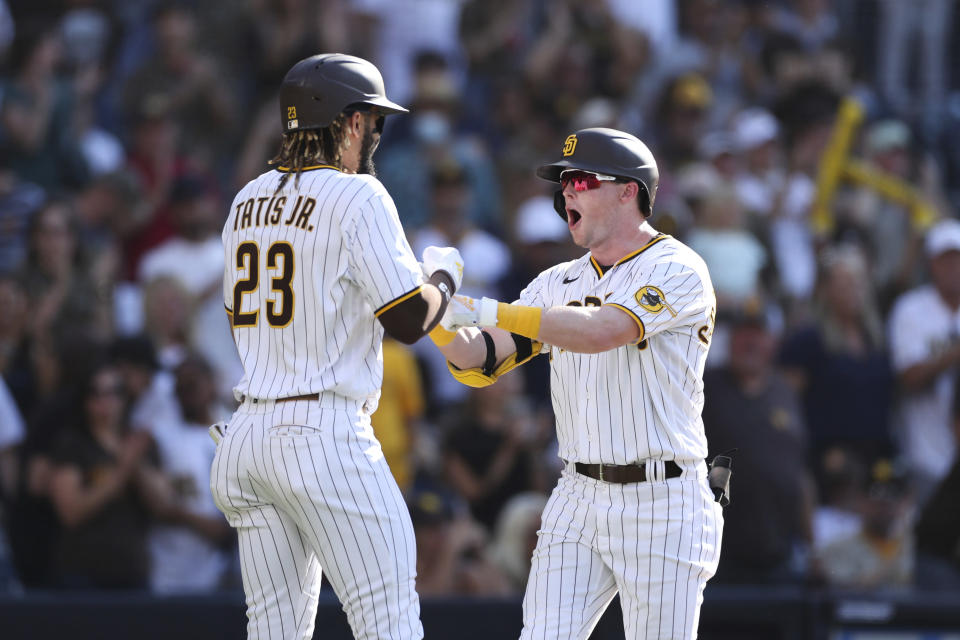 San Diego Padres' Jake Cronenworth, right, celebrates with Fernando Tatis Jr. (23) after hitting a two-run home run that scored them in the third inning of a baseball game against the Cincinnati Reds, Saturday, June 19, 2021, in San Diego. (AP Photo/Derrick Tuskan)