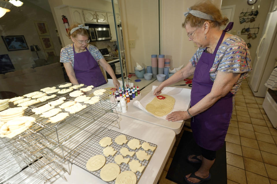 Julie Muller, who sells cookie decorating kits on Etsy, makes cutout cookies for her Black Lives Matter kits Tuesday, Sept. 22, 2020, in Houston. Amid all the Black Lives Matter themed T-shirts, face masks and signs appearing in recent months, some unconventional merchandise has been popping up on online crafts marketplace Etsy. (AP Photo/David J. Phillip)