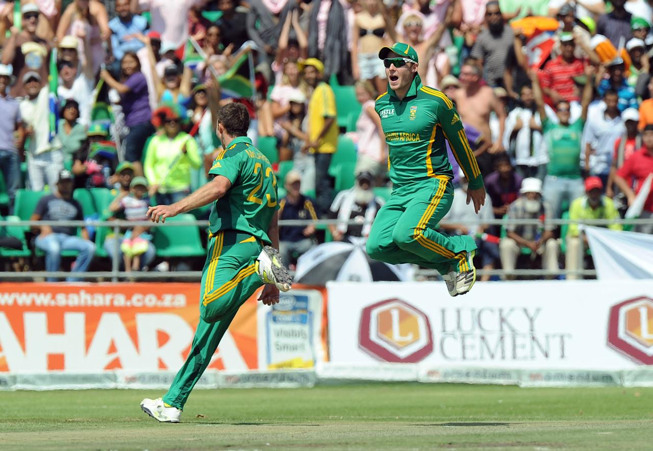 South Africa cricketer Ryan McLaren (L) , celebrates the wicket of Pakistan's cricketer Shoaib Malik  during the fifth and final One-Day Internationals (ODI) cricket match between South Africa and Pakistan in Benoni at Willowmoore Park on March 24, 2013. AFP PHOTO / ALEXANDER JOE        (Photo credit should read ALEXANDER JOE/AFP/Getty Images)