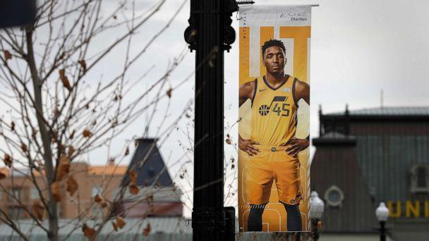 PHOTO: A poster of Utah Jazz guard Donovan Mitchell hangs near an empty main entrance at Vivint Smart Home Arena, in Salt Lake City, Utah, on March 13, 2020. (USA Today via Reuters)