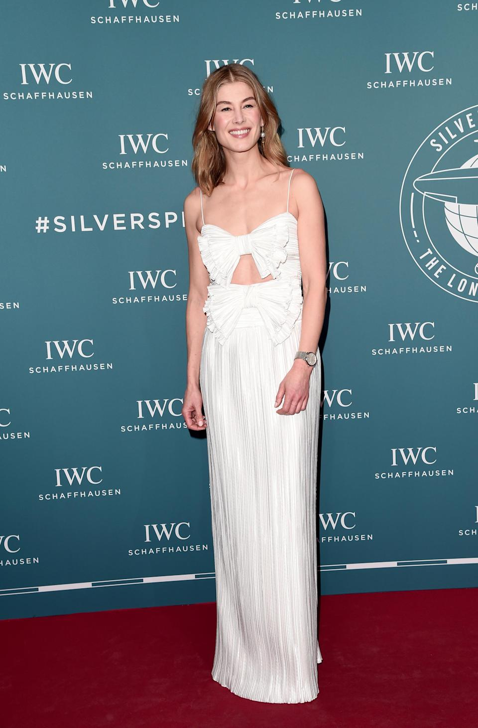 <p>Rosamund Pike is quickly becoming one of this month's best dressed stars. Need proof? Her latest Givenchy dress is another fine example. <em>[Photo: Getty]</em> </p>
