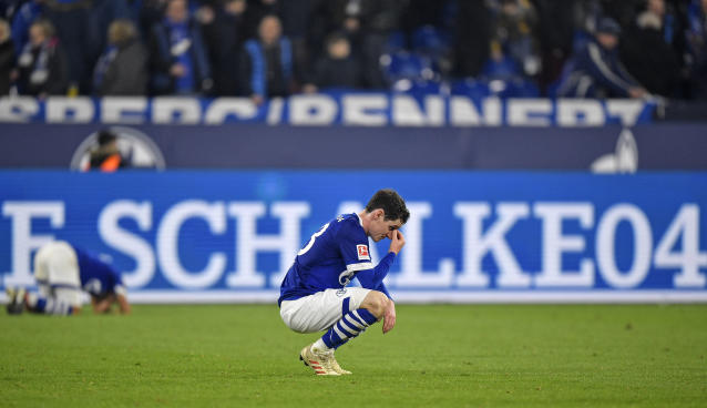 Schalke's Sebastian Rudy sits on the pitch disappointed after losing the German Bundesliga soccer match between FC Schalke 04 and Borussia Dortmund at the Arena in Gelsenkirchen, Germany, Saturday, Dec. 8, 2018. (AP Photo/Martin Meissner)
