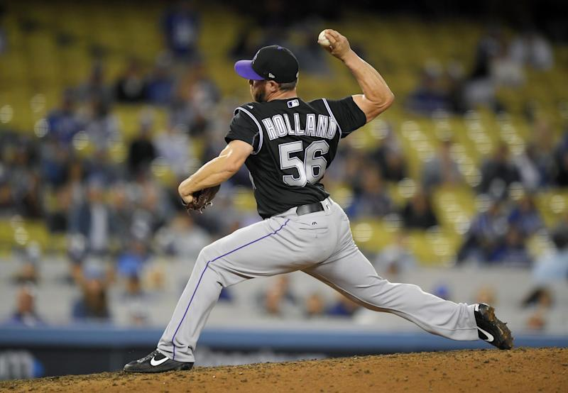 Greg Holland is using his slider more often this season as he transitions from playing in the American League to the National League. AP Photo/Mark J. Terrill)