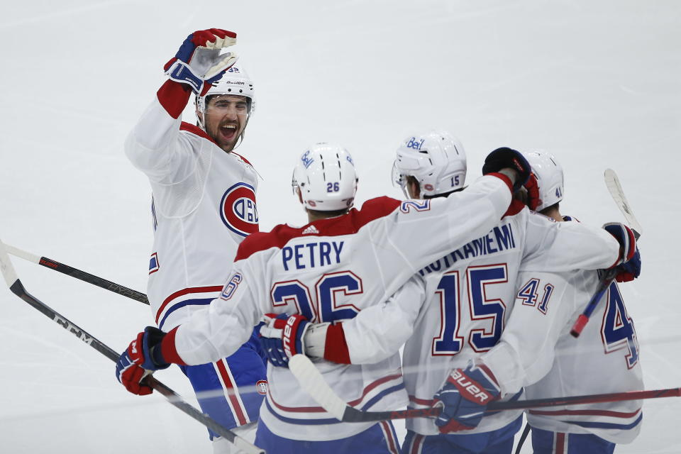Montreal Canadiens' Jesperi Kotkaniemi (15) celebrates his goal against the Winnipeg Jets with Erik Gustafsson (32), Jeff Petry (26) and Paul Byron (41) during the first period of Game 1 of an NHL hockey Stanley Cup second-round playoff series Wednesday, June 2, 2021, in Winnipeg, Manitoba. (John Woods/The Canadian Press via AP)