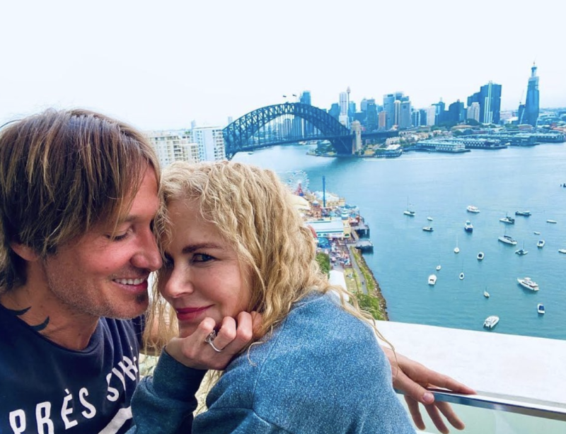 Nicole Kidman nestles into Keith Urban in front of the Sydney Harbour Bridge