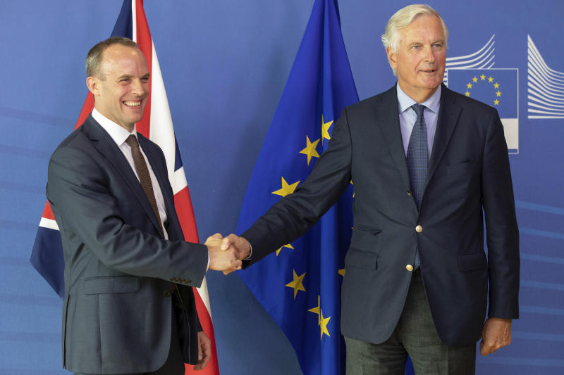 Britain's Secretary of State for Exiting the European Union Dominic Raab, left, and EU chief Brexit negotiator Michel Barnier shake hands during a press conference at EU headquarters in Brussels on Tuesday, Aug. 21, 2018. (AP Photo/Olivier Matthys)