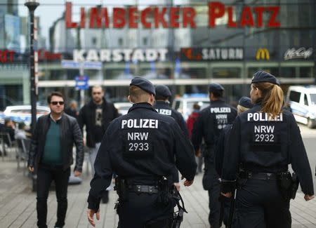 Police walks towards the Limbecker Platz shopping mall in Essen