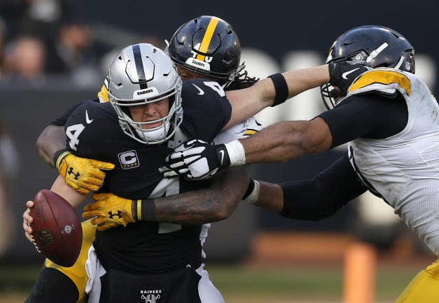<p>Oakland Raiders quarterback Derek Carr (4) is sacked by Pittsburgh Steelers outside linebacker Bud Dupree, rear, as defensive end Cameron Heyward, right, approaches during the second half of an NFL football game in Oakland, Calif., Sunday, Dec. 9, 2018. (AP Photo/D. Ross Cameron) </p>