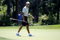 PHOTO: In this Aug. 7, 2016, file photo, President Barack Obama smiles after putting on the first green at Farm Neck Golf Club during his annual summer vacation on Martha's Vineyard, in Oak Bluffs, Mass. (Jonathan Ernst/Reuters, FILE)