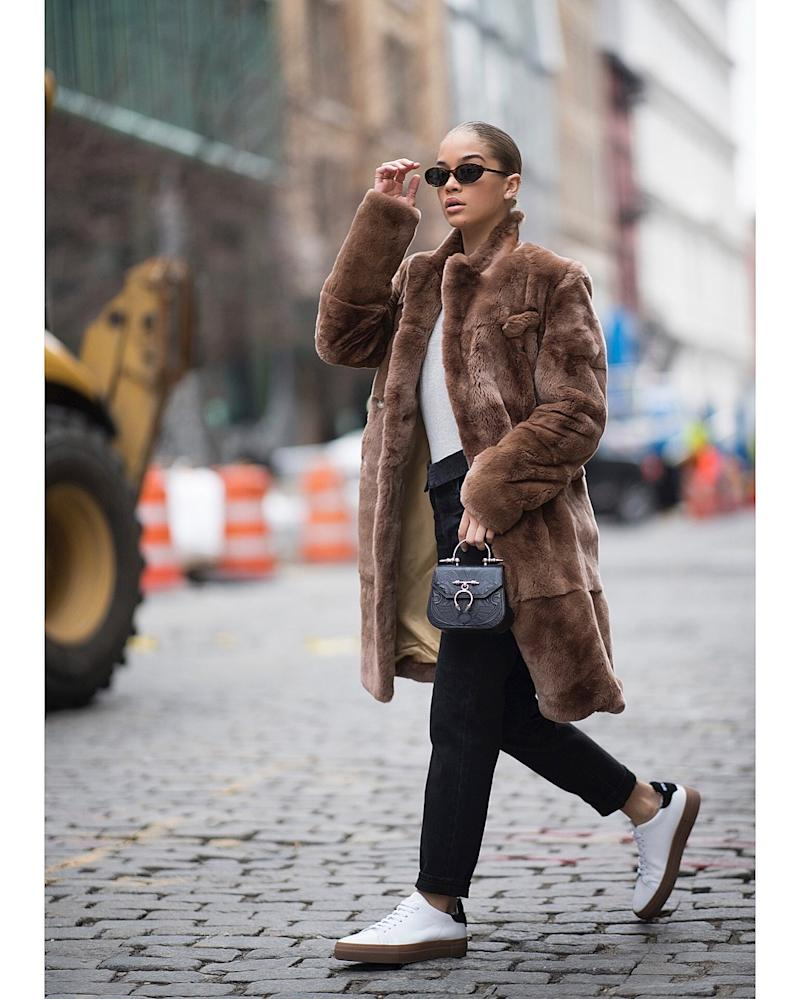Model Jasmine Sanders makes the case for minimalist street style with her natural skin and slicked back bun.