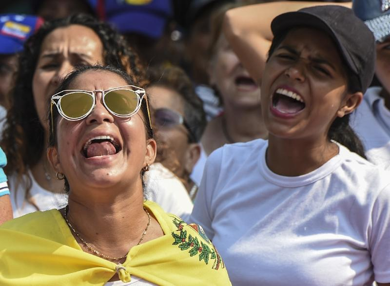 Supporters of Venezuelan opposition leader and self declared acting president Juan Guaido, shout slogans at a rally in Urena, Venezuela to press the military to let in US humanitarian aid, on February 12, 2019 (AFP Photo/Juan BARRETO)