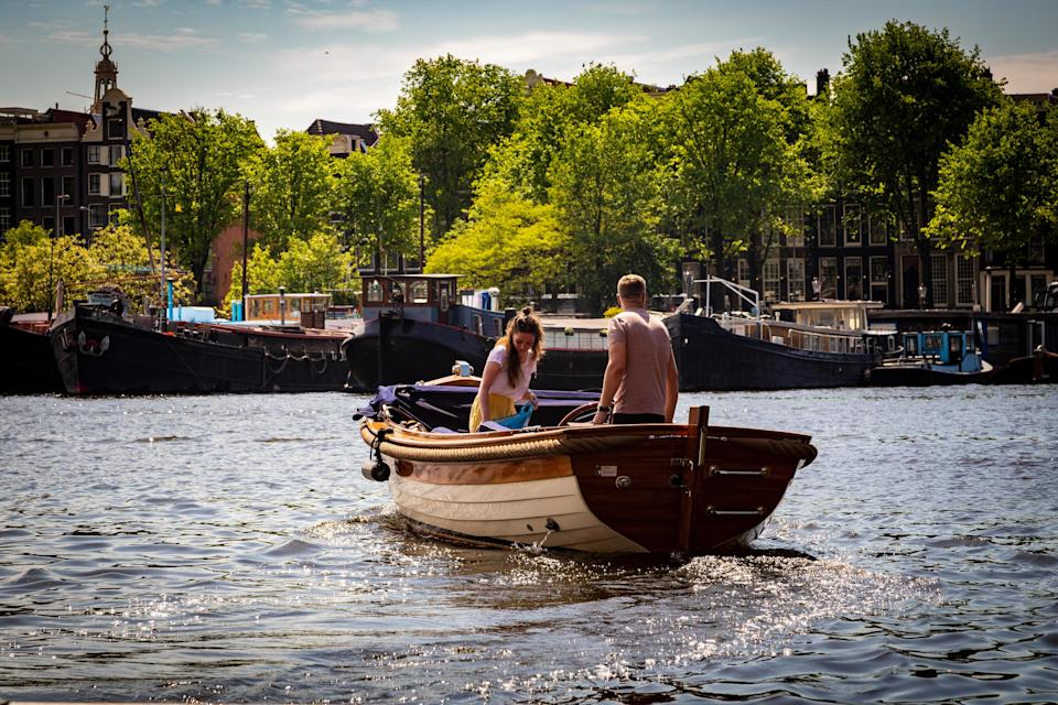 Couple riding a boat in Amsterdam