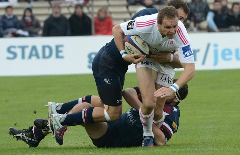 Bordeaux's Jandre Marais (L) tackles Stade Francais' David Attoub (R) during a French Top 14 rugby union match Begle-Bordeaux vs Stade Francais, at the Chaban-Delmas stadium in Bordeaux, southwestern France