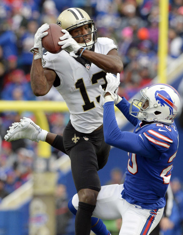 <p>New Orleans Saints' Michael Thomas (13) catches a pass in front of Buffalo Bills' Shareece Wright (20) during the second half of an NFL football game Sunday, Nov. 12, 2017, in Orchard Park, N.Y. (AP Photo/Adrian Kraus) </p>