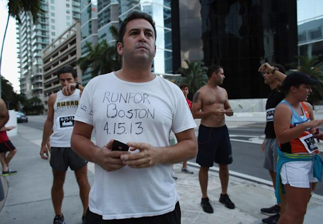 "MIAMI, FL - APRIL 16: Runner Lalo Senior wears a shirt where he wrote ""RunFor Boston 4.15.13,"" as the Baptist Health South Florida Brickell Run Club honors the victims of the Boston Marathon bombings on April 16, 2013 in Miami, Florida. The event drew approximately 1,000 people who wanted to honor the three people killed in the Boston bombing as well as the over one hundred who were injured. (Photo by Joe Raedle/Getty Images)"