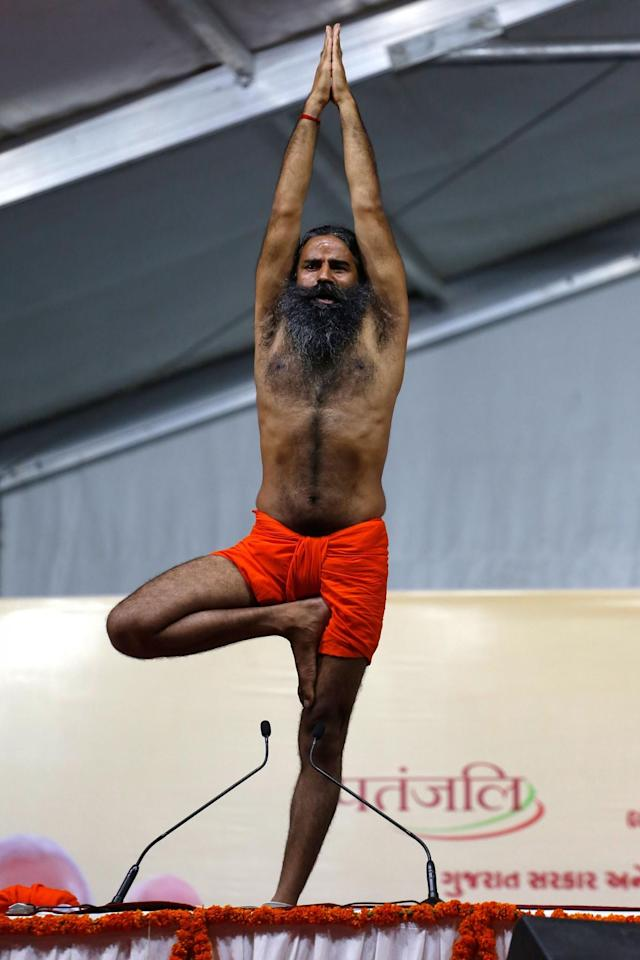 <p>Yoga guru Baba Ramdev performs Yoga during International Yoga Day celebrations in Ahmadabad, India, Wednesday, June 21, 2017. (Photo: Ajit Solanki/AP) </p>