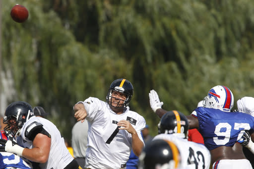 Pittsburgh Steelers quarterback Ben Roethlisberger (7) passes as Buffalo Bills defensive tackle Corbin Bryant (97) pressures during a combined NFL football training camp session in Latrobe, Pa. on Wednesday, Aug. 13, 2014. (AP Photo/Keith Srakocic)