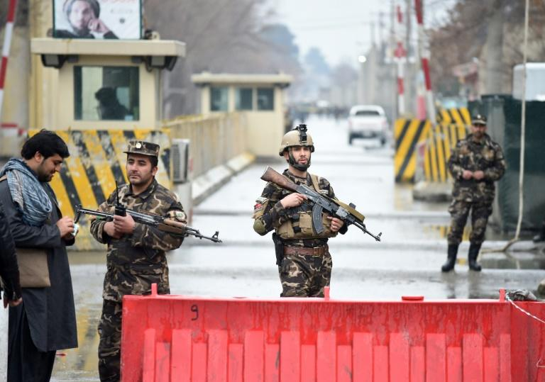 Afghan security personnel seal off the site of a suicide attack near the diplomatic area of Kabul