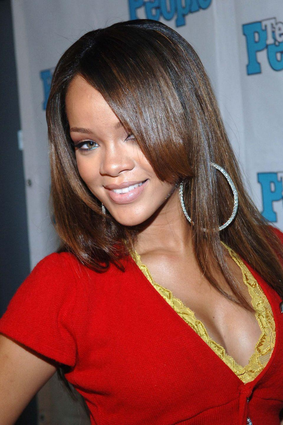 <p>The likely origin of our collective side bangs obsession. Rihanna wears them long with light brown highlights. </p>