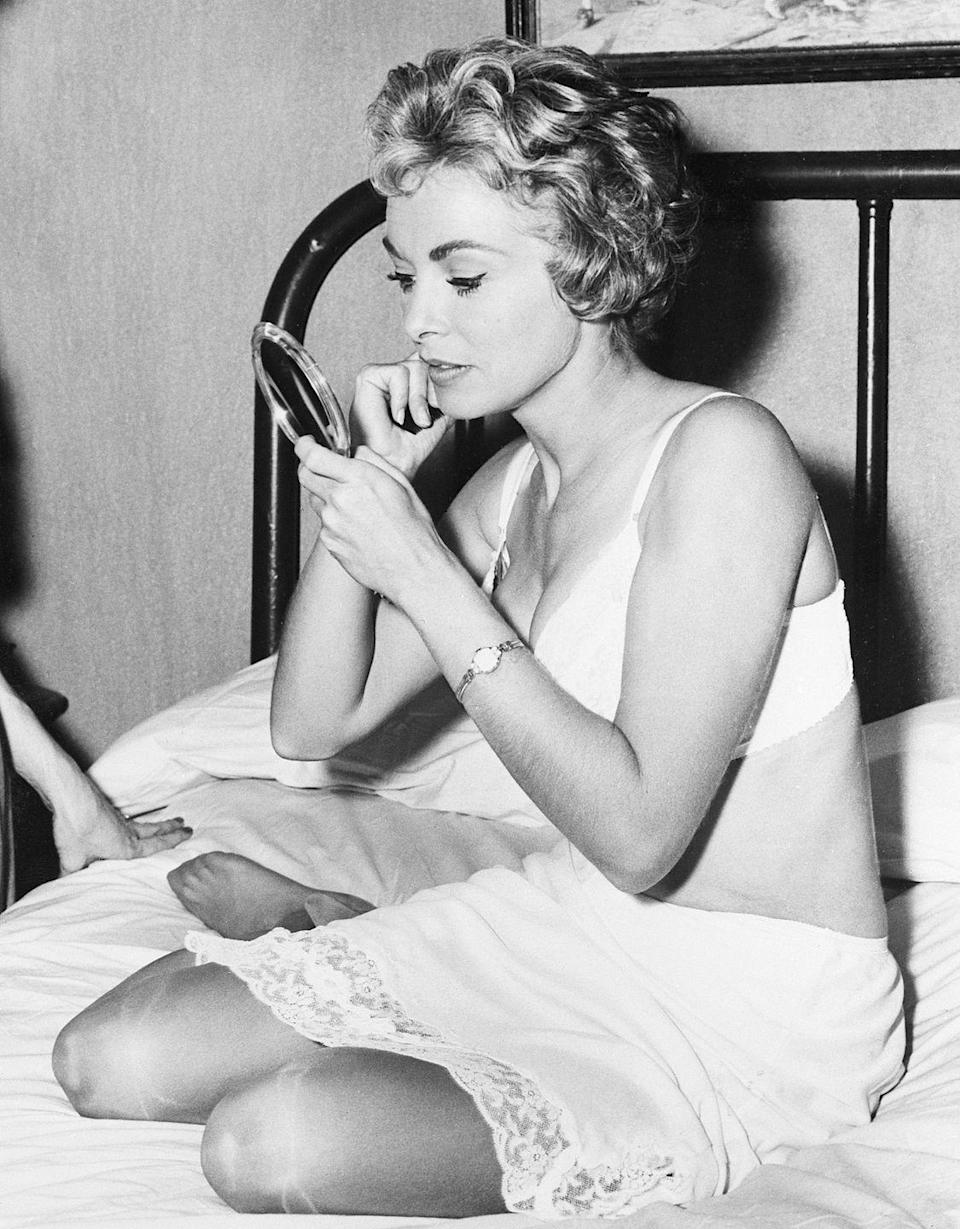 <p><em>Psycho </em>actress Janet Leigh touches up her makeup in-between scenes on the set of the classic thriller movie. </p>
