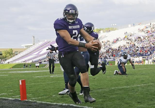 Northwestern quarterback Kain Colter (2) scores a touchdown during the second half of an NCAA college football game against Maine in Evanston, Ill., Saturday, Sept. 21, 2013. (AP Photo/Nam Y. Huh)