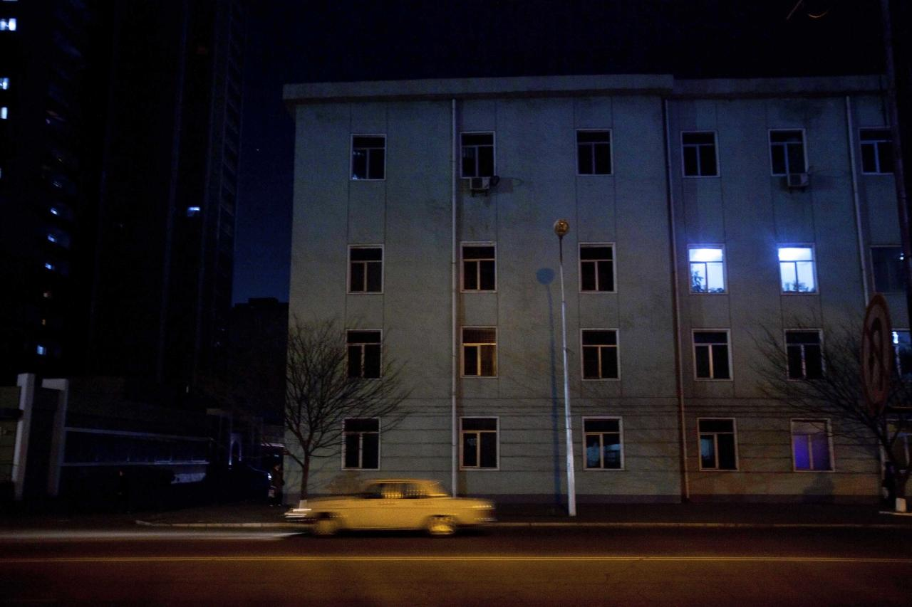 In this April 12, 2011 photo, a car drives along a street at night in central Pyongyang, North Korea. (AP Photo/David Guttenfelder)
