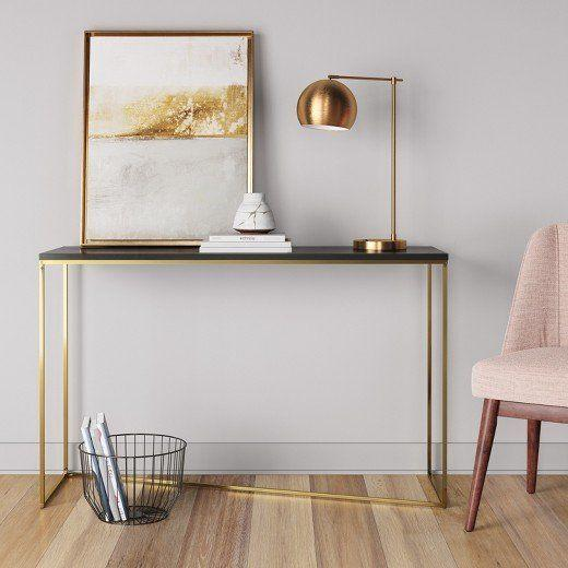 """<a href=""""https://www.target.com/p/sollerod-console-table-brass-and-black-project-62-153/-/A-50403347#lnk=newtab"""" target=""""_blank"""">Shop it here</a>."""