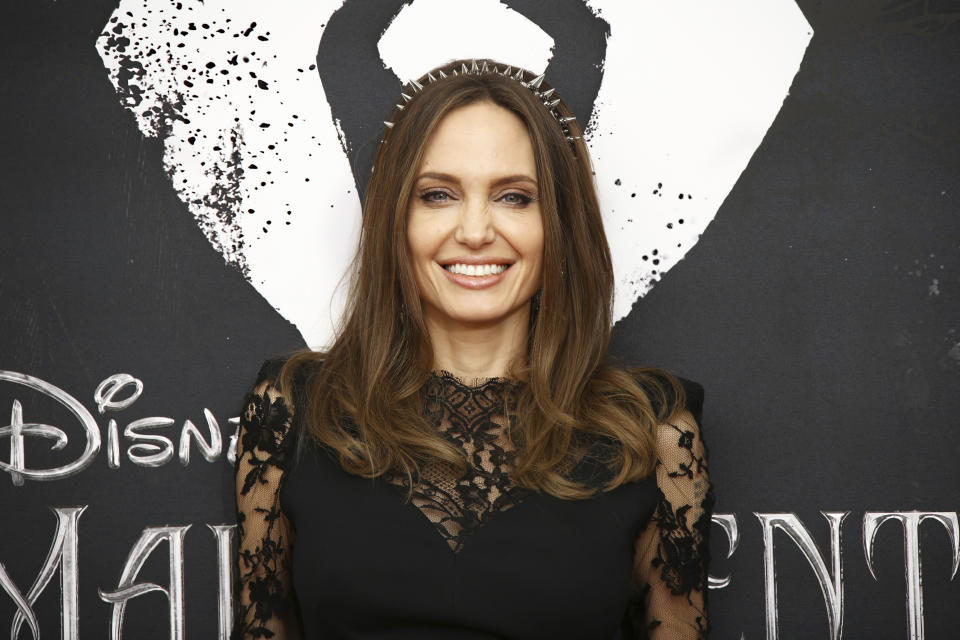 Actress Angelina Jolie poses for photographers at the photo call for the film 'Maleficent Mistress of Evil' in central London, Thursday, Oct. 10, 2019. (Photo by Joel C Ryan/Invision/AP)