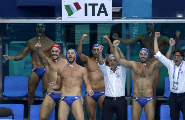 Italian bench players react during their men's water polo gold medal match against Spain at the World Swimming Championships in Gwangju, South Korea, Saturday, July 27, 2019. (AP Photo/Mark Schiefelbein)