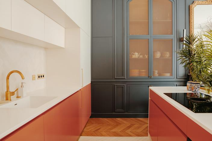 The kitchen is painted in Farrow & Ball's Stiffkey Blue and Little Greene's Orange Aurora.