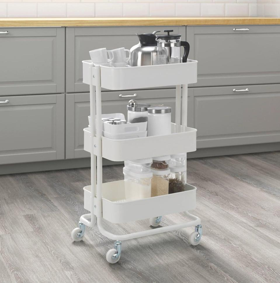 "<p>With deep shelves, the <a href=""https://www.popsugar.com/buy/R%C3%A5skog%20Utility%20Cart-447004?p_name=R%C3%A5skog%20Utility%20Cart&retailer=ikea.com&price=30&evar1=casa%3Aus&evar9=46151613&evar98=https%3A%2F%2Fwww.popsugar.com%2Fhome%2Fphoto-gallery%2F46151613%2Fimage%2F46152193%2FR%C3%A5skog-Utility-Cart&list1=shopping%2Cikea%2Corganization%2Ckitchens%2Chome%20shopping&prop13=api&pdata=1"" rel=""nofollow noopener"" target=""_blank"" data-ylk=""slk:Råskog Utility Cart"" class=""link rapid-noclick-resp"">Råskog Utility Cart</a> ($30) can hold large jars, pots, pans, and all other cooking tools. Tuck it away when it's not in use and easily roll it out when it's needed.</p>"
