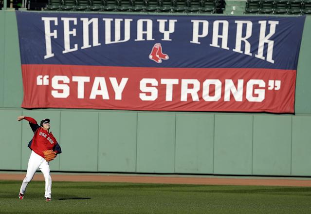Boston Red Sox's Koji Uehara throws during baseball practice Monday, Oct. 21, 2013, in Boston. The Red Sox are preparing to play the St. Louis Cardinals in Game 1 of the World Series on Wednesday. (AP Photo/Darron Cummings)