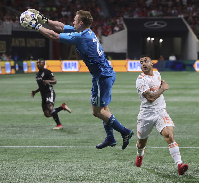 Sporting Kansas City goalkeeper Tim Melia blocks a shot with Atlanta United forward Hector Villalba watching during the first half of an MLS soccer match Wednesday, May 9, 2018, in Atlanta. (Curtis Compton/Atlanta Journal-Constitution via AP)